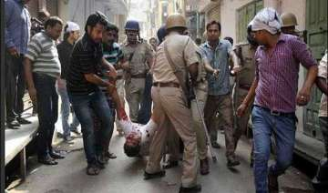 curfew in haryana town after communal violence -...