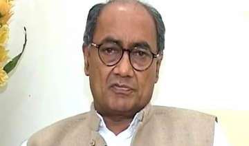 digvijay seeks action against swamy for communal...