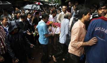 families of victims await release of bodies from...