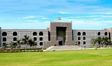 guj hc acquits 12 sentenced to life in post...