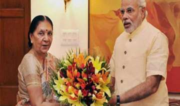 gujarat cm thanks pm for increase in height of...