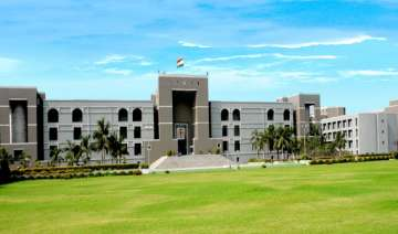 gujarat hc seeks state s reply on land allocation...