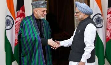 hamid karzai meets pm urges indian companies to...