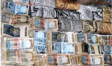 handle your money carefully currency notes...