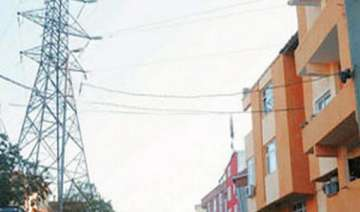 high tension wires passing through congested...
