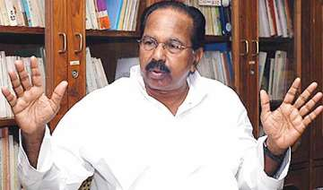 moily takes charge says he s happy with pm sonia...