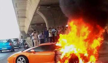 lamborghini catches fire driver escapes unhurt -...