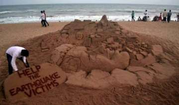 sand artist s message for helping earthquake...