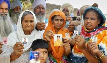 relatives of is captured workers seek answers...