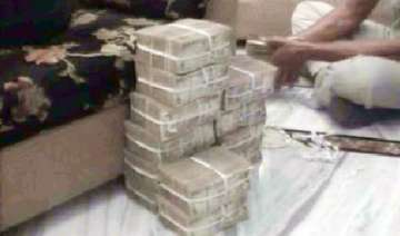 rs 1.15 crore cash seized from dairy official s...