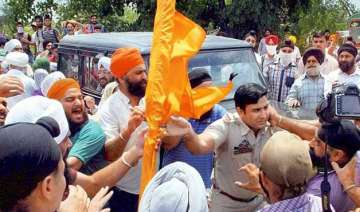 sikh protestors clash with police 15 injured -...