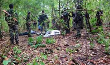 naxals torch 17 vehicles at mining site in...