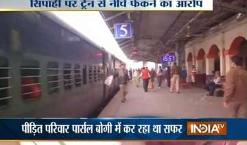 rpf jawan throws woman out of running train in...
