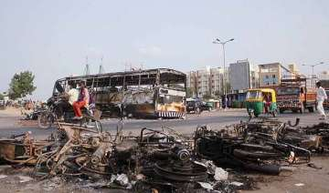 uneasy calm in violence hit gujarat toll rises to...