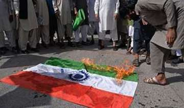 protesters burn indian flag in pok against...