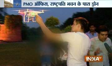 exclusive foreign national flying drone near...