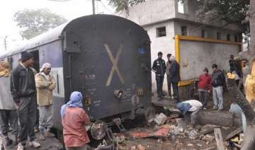 six injured as express train rams into a temple -...