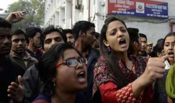students protest outside police station over...
