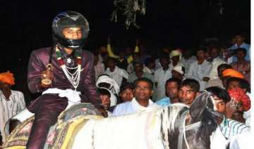 stones pelted on dalit groom for riding horse in...
