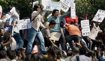 scores of students detained during protest over...