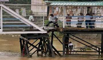 train services in west bengal hit by heavy rains...