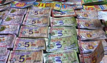 lottery scam top ips officer suspended in...