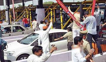 protest against noida toll tax traffic hit -...