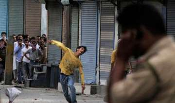 eight cops among 20 injured in fresh clashes in...