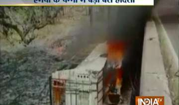 21 dead as bus falls off bridge catches fire in...