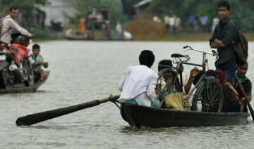 flood situation in assam grim over 2 lakh people...