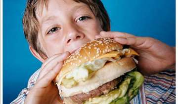 junk food causing puberty to hit at age 6 experts...