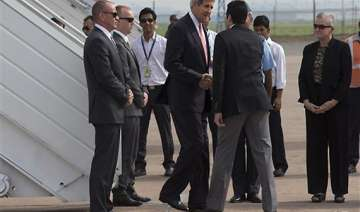kerry lands in india climate change business on...