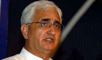 khurshid admits justice delivery system slow -...