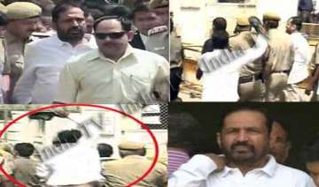 man hurls slipper at kalmadi inside delhi court...