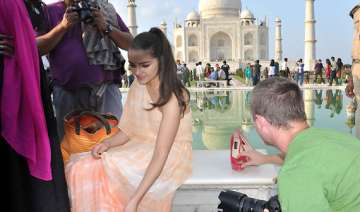 miss universe poses before taj with sandals...