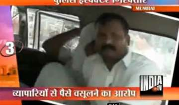 mumbai police inspector caught taking bribes from...