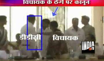 rjd mla slaps district official in jharkhand -...