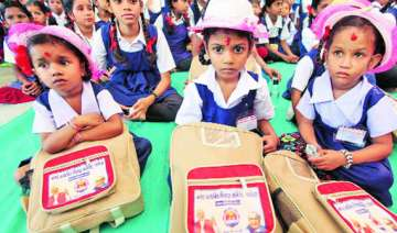 schoolbags with atal modi photos distributed in...