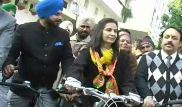 sidhu s wife navjot rides bicycle to file...