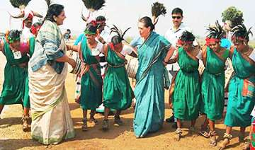 sonia surprises many by dancing with tribal women...