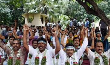 striking ap government employees to hold talks...