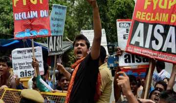 students protest over university row detained -...
