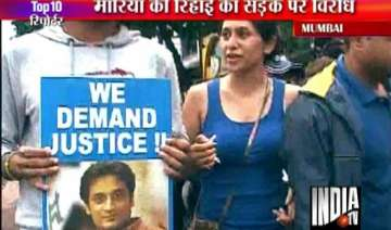 supporters of slain neeraj grover hold protest...