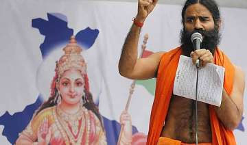 swami ramdev threatens fast against illegal...
