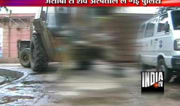 up police takes body of a man hanging from a jcb...