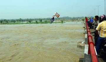 up receives fresh rains major rivers on rise -...