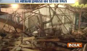 one dead over 50 trapped in building collapse in...