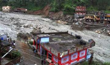 uttarakhand scores of houses washed away in...