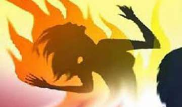 woman sets herself daughters on fire in up...
