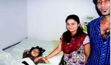 4 year old girl survives fall from 5th floor in...